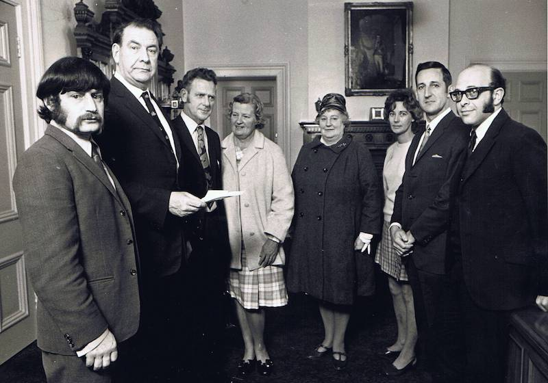 WDS Members at the Wellington City Council in 1971. 2nd from left is Sir Francis Kitts (Mayor); 3rd from left is Max Howell (WDS President); 4th and 5th from left are Doreen Howell, and Lilian Walton (Lisison Officer).