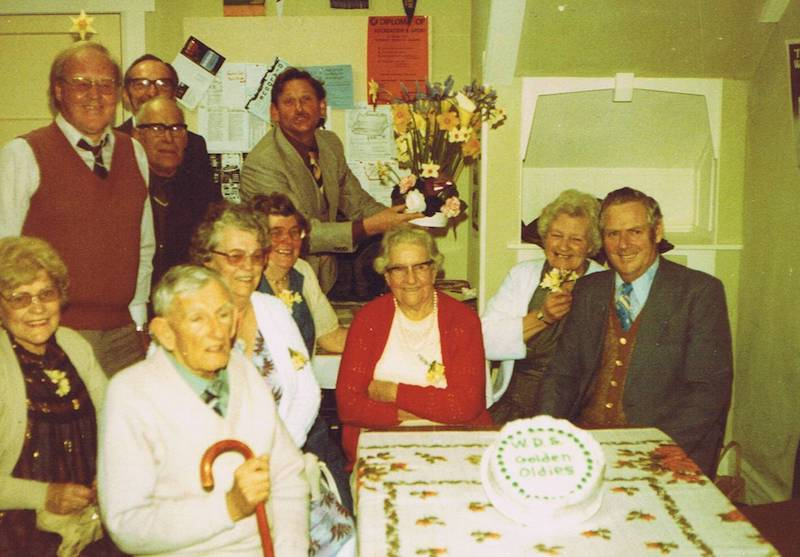 1980s Golden Oldies Get Together: Standing (L to R) Jim Monk, Wilson Barrett, Noel Rees, Bill Rees. Sitting (L to R) Mary Rees, Jack Mahoney, Nan Mahoney, Jean Monk, Bessie LeMarquant, Doreen Howell, Max Howell.